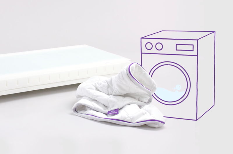 Washing machine with mattress cover for cot.